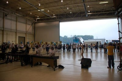 Coaches parked in front of the hanger at Dobbins Naval Air Station