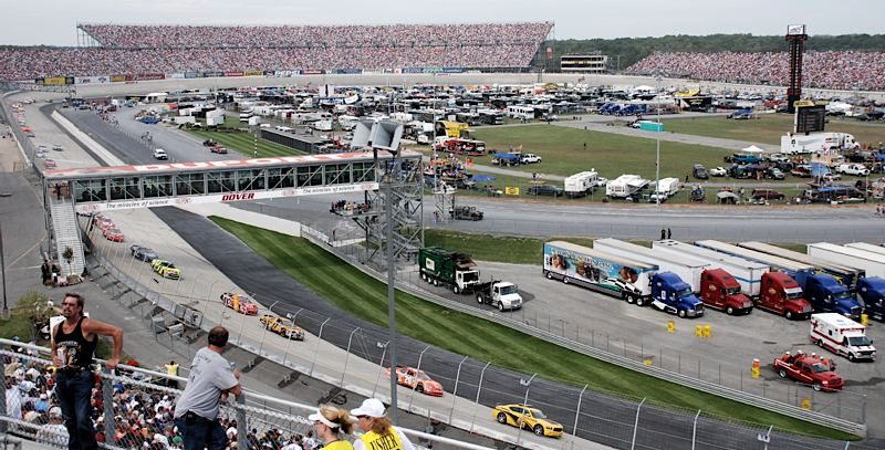 Dover International Speedway overview with the pace car leading the pack